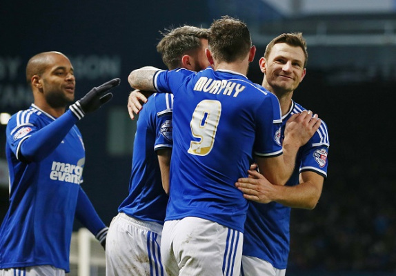 Ipswich's Tommy Smith tells team-mate: You Berra forget it!