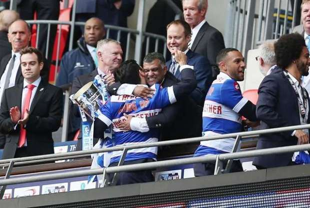 Glory times: Faurlin celebrates play-off success with chairman Tony Fernandes in 2013/14 (Action Images / Matthew Childs)