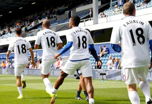 Popular: QPR players warm up wearing t-shirts in honour of their injured team-mate (Action Images / Jed Leicester)