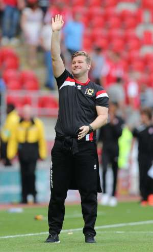 Young boss: MK Dons manager Karl Robinson (Action Images / Alex Morton)