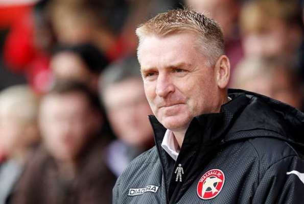 Dean Smith signs new deal with Saddlers