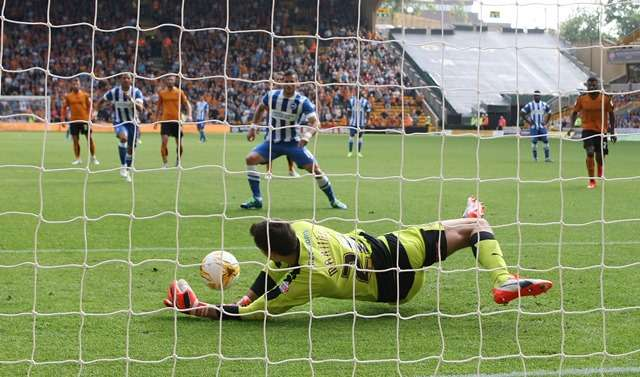 Hero: Martinez saves a penalty from Brighton's Tomer Hemed in their 0-0 draw (Photo by Action Images)