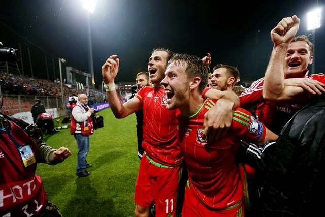 Chris Gunter celebrates with Gareth Bale as Wales enter 2016 the highest ranked British nation (Photo by Action Images via Reuters / Matthew Childs)