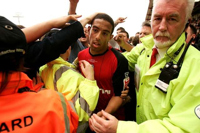 Promotion: Feeney surrounded by fans after rescued Bournemouth secure promotion in 2010 (Photo by Action Images / Frances Leader)