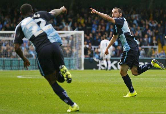 Wycombe sign Michael Harriman on permanent deal
