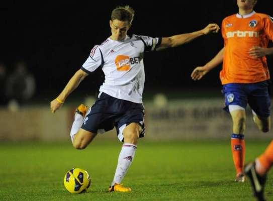 Former Bolton midfielder Holden retires