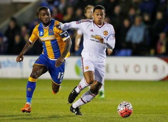 Team-mates: Shrewsbury defender Abu Ogogo