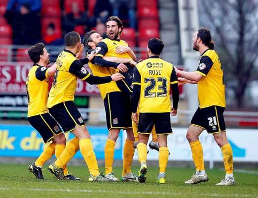Holmes cools talk of Cobblers title win
