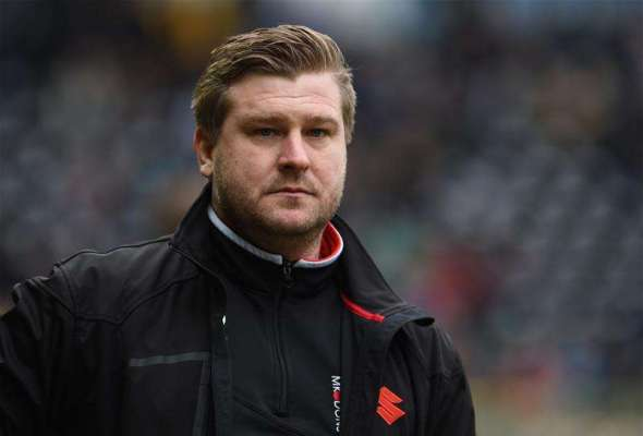Karl Robinson to continue as MK Dons boss