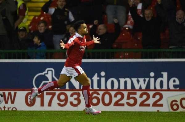 Swindon striker Ajose defends boss Williams
