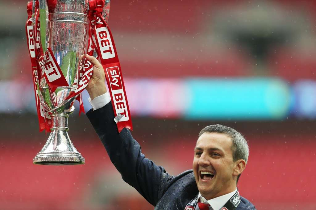 Serious competition: Fleetwood Town chairman Andy Pilley holds aloft the League Two play-off final trophy in 2014 (Photo by Action Images)