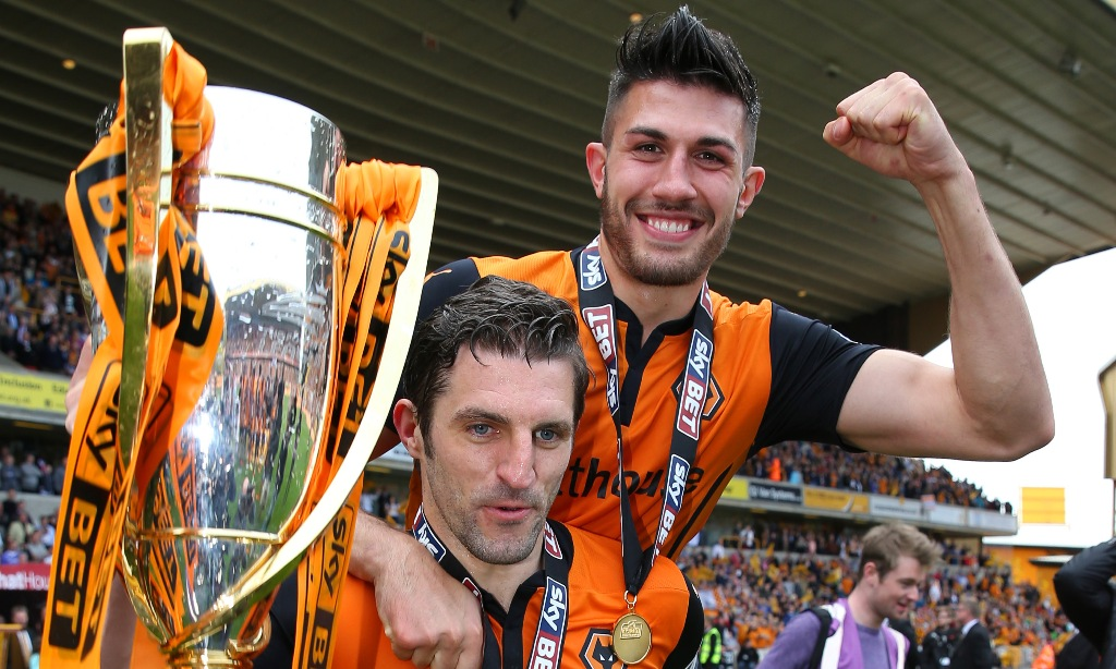 Party time: Sam Ricketts and Danny Batth celebrate Wolves' promotion to the Championship