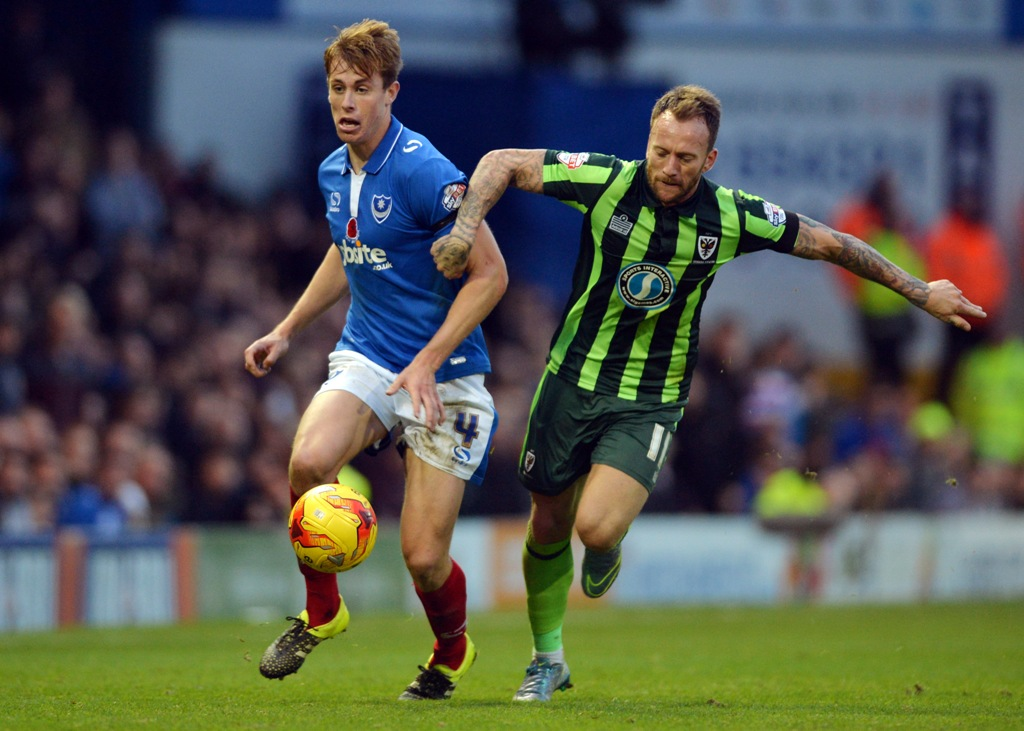 Wesbter (left) in action for his boyhood club Pompey last season (Picture: Action Images via Reuters)