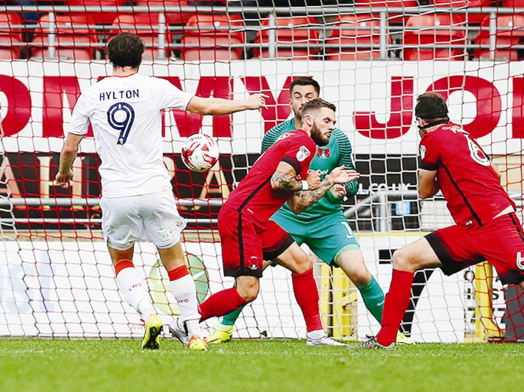On the spot: Hylton scores from the spot against Leyton Orient (Picture: Action Images)