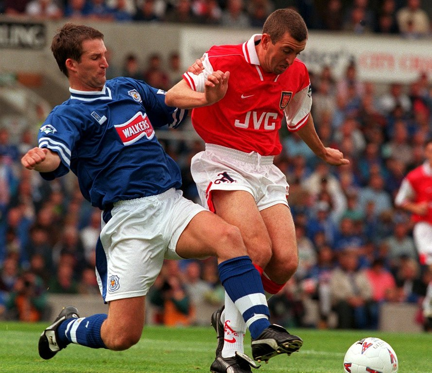 Fox on a run: Grayson, in his Leicester days, tackles Nigel Winterburn (photo by Action Images)