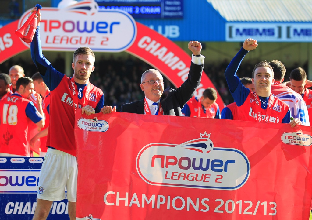 Gillingham chairman Paul Scally (middle) celebrates the club winning League Two. (Picture: Action Images)
